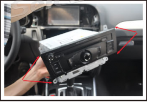 take out four screws which fixed the original CD player and remove the player