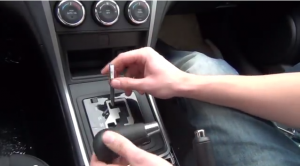 unscrew and remove the shift knob