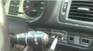 Take out the screw on drivers' side