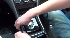 Loosen and remove trim panels(total 2) beside the shift knob