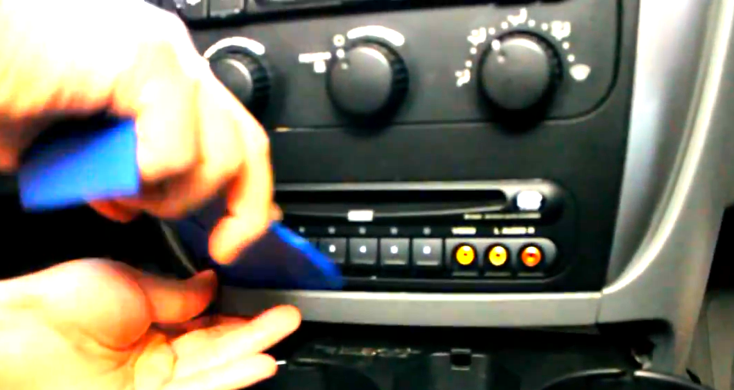 how to change a battery in 2005 grand caravan