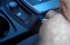 1. Remove the panel behind the gear shifter with a lever