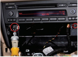 5.Unscrew the fixed screws marked in the following photo, then pull out the original car's CD player