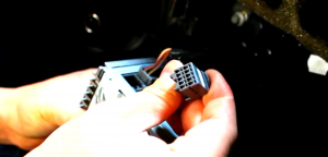 6.Disconnect the smaller harness on the behind of the factory radio.