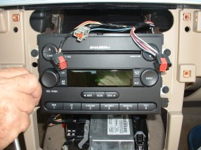 Remove screws securing radio to the vehicle, and take the original radio out of the dash