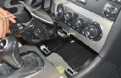 Remove the car charger and ashtray assembly