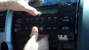 Take the original car radio out of the dash with your hands