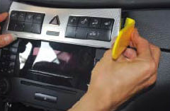 Remove the heated seat and control panel assembly