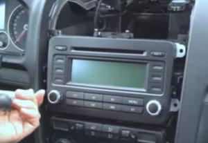 Unscrew four screws holding the original car radio with a screwdriver