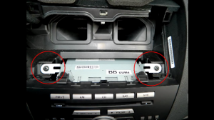 Now use a Phillips-head screwdriver to remove both sides screws of the radio as the picture shows