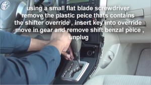 2-1.Using a small flat blade screwdriver to remove the plastic piece that contains the shifter override, insert key into override, move the gear and remove the shift bezel piece, then unplug the con