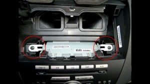 Remove both sides screws of the radio as the picture shows with Phillips-head screwdriver