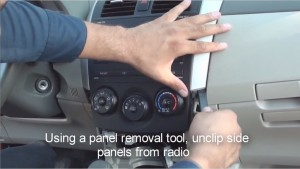 4-1.Using a panel removal tool, unclip side panels from the original radio