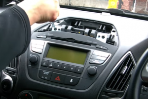 Remove two screws on the top that fixed the radio on the dashboard with a screwdriver