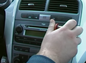 Insert the release keys into the slots of the original radio