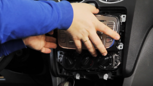 Gently remove the original car radio out of the dash
