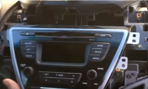 Gently pull out the original head unit. Then unplug the connectors at the back of the factory radio