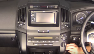 Remove the padded covers from the two sides of the lower section at the center of the dash