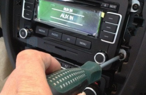 Remove four screws that fixed the radio on the dashboard