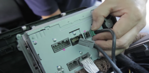 Disconnect the connectors at the back of the radio