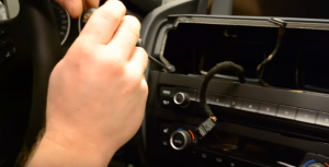 Use a screwdriver to remove the screws that fix the radio panel